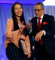 Sui Len Par, left, from Perry Meridian High School, laughs with Rafael Sanchez as she accepts her award during the Abe Lincoln Awards ceremony at the Ivy Tech Culinary and Conference Center, Friday, Feb. 7, 2020.