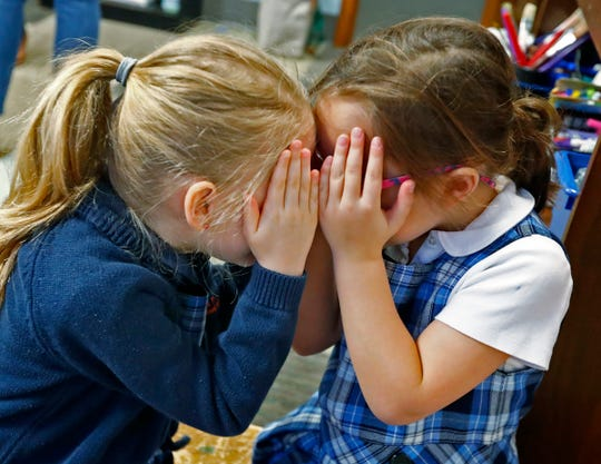 Madeleine Sahlein, left, and Kate Daneri get a close look at each other during their Spanish immersion kindergarten class at the International School of Indiana lower school, Monday, Feb. 3, 2020. The school offers foreign language immersion classes.
