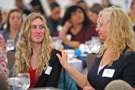 Paige Moore, left, from Roncalli High School, smiles and looks at her mother, Keri Moore, as Paige wins the top award during the Abe Lincoln Awards ceremony at the Ivy Tech Culinary and Conference Center, Friday, Feb. 7, 2020.