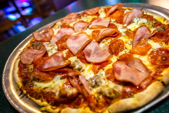 A medium thin crust pepperoni, sausage, beef and Canadian bacon pizza is seen, Thursday, Feb. 6, 2020, at Sam's Pizza in Iowa City, Iowa.