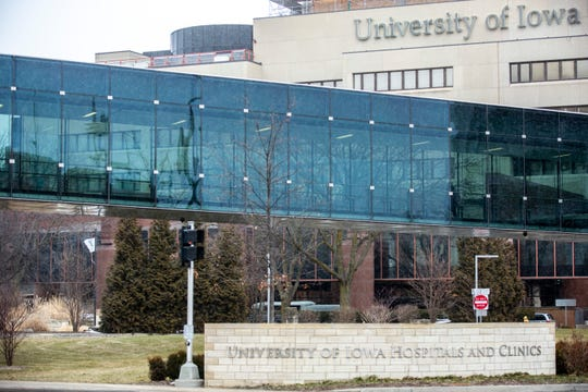 People use the skywalk between a parking ramp and the University of Iowa Hospitals and Clinics, Friday, Feb. 7, 2020, at 200 Hawkins Drive in Iowa City, Iowa.