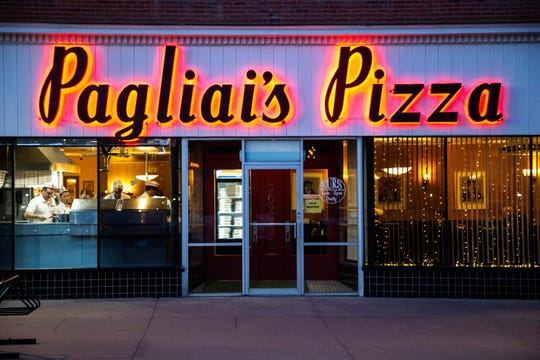 Employees are seen making pizzas in the front window, Thursday, Feb. 6, 2020, at A & A Pagliai's Pizza in Iowa City, Iowa.