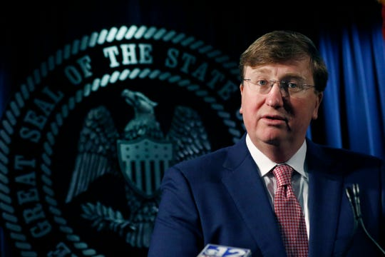 Republican Gov. Tate Reeves speaks with reporters on a variety of issues, including the state prison system , Thursday, Feb. 6, 2020, in Jackson, Miss. (AP Photo/Rogelio V. Solis)