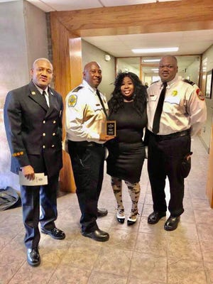 Angela Parks stops for a photo with honorees Bryan Bowers, Carlos Perry and Treasure Henning after the Butterflies and Bookworms event to celebrate Black History Month at the Jackson-Madison County Library.