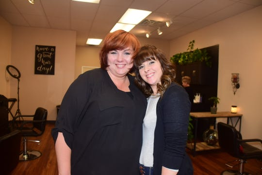 """Stylists Tammy Beaird and Adrian West pause at Messi Heads Salon on Saturday, Feb. 1. """"This is a fun place, there's no place quite like it."""" said Beaird. 2020"""