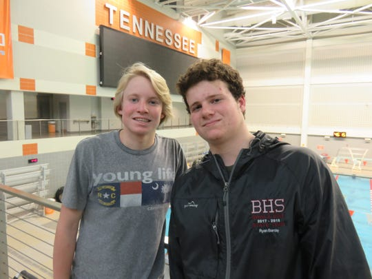 West High swimmer Pep Arnwine, left, and Ryan Barclay of Bearden High stand along the grandstand viewing area at the UT Allan Jones Intercollegiate Aquatic Center on Feb. 3, 2020. The two are among the top local prep swimmers.