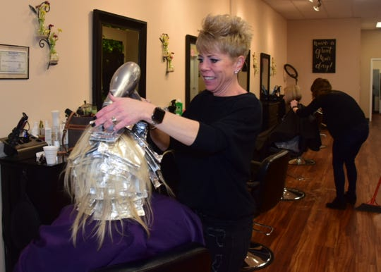 Owner Tracy Messineo works on a client at Messi Heads Salon, 10612 Hardin Valley Road. 02/01/20