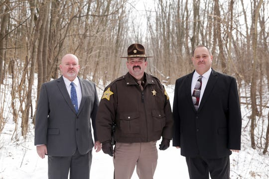 Carroll County Sheriff Tobe Leazenby, center, and detectives, Tony Liggett, left, and Kevin Hammond, right, pose for a photo on the Monon High Bridge Trail, Friday, Feb. 7, 2020 in Delphi.