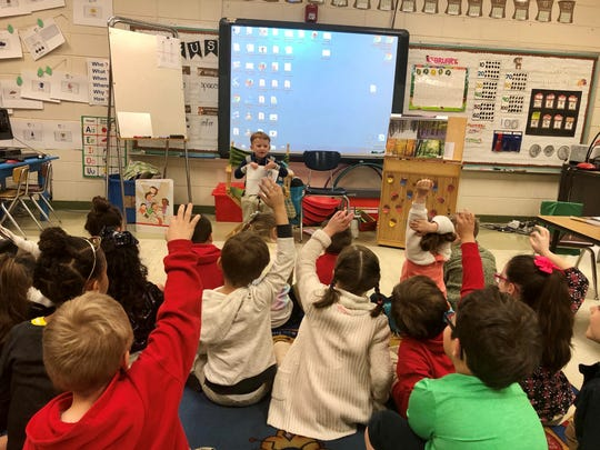 Thirty-six students at Broadmoor Elementary got to be teachers and principal for a day Friday, Feb. 7, 2020. Sam Hetherwick, 5, leads his kindergarten class in reading a book as Teacher for a Day.