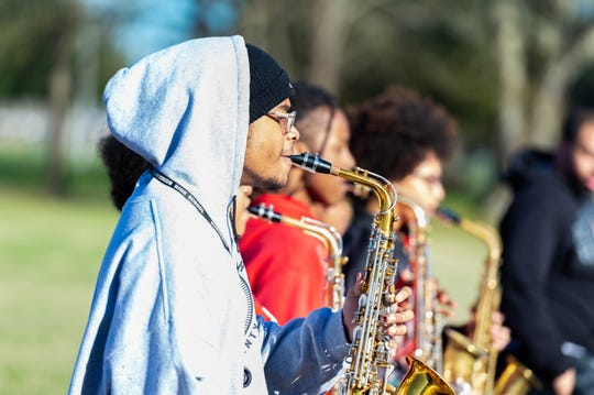Members of the Northside High School Marching Band are putting in the work to be ready to perform in five Mardi Gras parades in February. They practice pacing and staying in formation as they play after school Feb. 7, 2020.