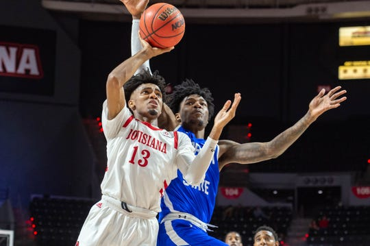 Shown here during first-half action, Mylik Wilson (13) scored the game-winner for UL against Georgia State on Thursday night.