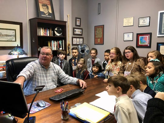 Thirty-six students at Broadmoor Elementary got to be teachers and principal for a day Friday, Feb. 7, 2020. Principal David Zielinski shows them around the teachers' lounge and administrators' offices, including the school camera system.