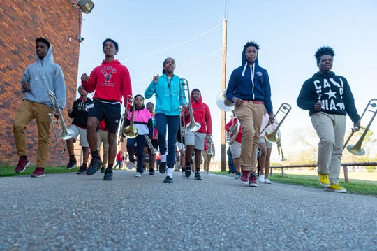 Members of the Northside High School Marching Band keep time as they march around school Feb. 7, 2020. They practice every week to be ready to perform in five Mardi Gras parades in February.