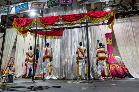 Backstage at the Cajundome Convention Center with the Krewe of Apollo as members put the final touches on their one of a kind back pieces that will be worn during the Ball on Saturday Night.  Friday, Feb. 7, 2020.