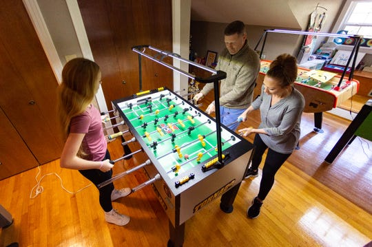 Terry, Keisha and Sullivan Rue are world-renowned foosball players featured in a new documentary.  Thursday, Feb. 6, 2020.