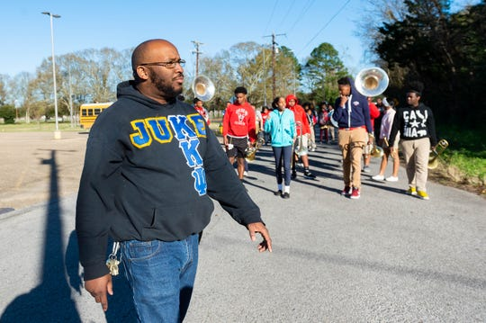 Northside High School Marching Band Director Alex Thomas leads his students toward a neighborhood street near the school Feb. 7, 2020, as a way to practice for several upcoming Mardi Gras parades.