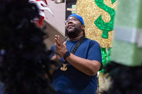 Sherman Bernard, first-time costumer, contemplates his back piece backstage at the Cajundome Convention Center with the Krewe of Apollo as members put the final touches on their one of a kind back pieces that will be worn during the Ball on Saturday Night.  Friday, Feb. 7, 2020.