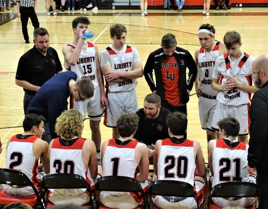 Liberty Union coach Pat Blevins talks with his team during a timeout during the Lions' 79-61 win over Fisher Catholic Thursday night.