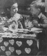 "Roberta B. Savage and Cecil Anderson were first graders at South School when this photo was taken for the Eagle-Gazette and appeared on Feb. 14, 1950. The photo title was ""Schoolroom Valentine Box Still There."""