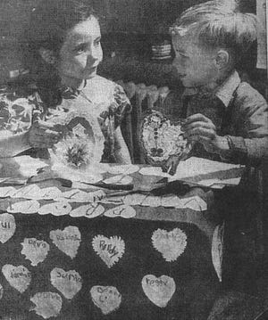 """Roberta B. Savage and Cecil Anderson were first graders at South School when this photo was taken for the Eagle-Gazette and appeared on Feb. 14, 1950. The photo title was """"Schoolroom Valentine Box Still There."""""""