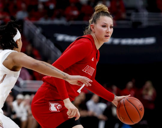 Louisville's Kylee Shook brings the ball up court against FSU on Feb. 6, 2020.