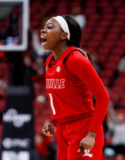 Louisville's Dana Evans celebrates after knocking down a three against FSU on Feb. 6, 2020.
