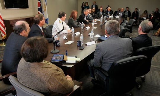 Former Ohio Governor John Kasich and Lt. Governor Mary Taylor, along with a representative from the Centers for Disease Control & Prevention, local officials and health officials, attend a news conference addressing an update on the status of Ebola in Ohio in October of 2014. (Ed Suba Jr./Akron Beacon Journal file photo)
