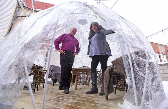 The Vault owners Ben & Cindy Lash have added three heated igloos to the patio to allow customers to enjoy food and drinks outside in the cold weather.