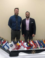 Dr. Joel Provenzano, a pulmonary doctor with OhioHealth, left, spoke to Kiwanis about lung cancer screening in 2019. Manoj Sharma, immediate Kiwanis past President, is on the right.