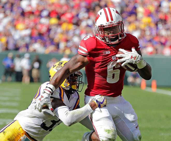 Former Wisconsin Badgers running back Corey Clement looks to shed a tackle against LSU during a game at Lambeau Field on Sept. 3, 2016. UW will play another game at Lambeau Field, but this time it will be a night game, against Notre Dame on Oct. 3.