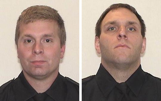 Milwaukee Police Officers Robert Parks, left, and Adam Maritato