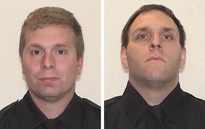 Milwaukee Police Officers Robert Parks, left, and Adam Maritato