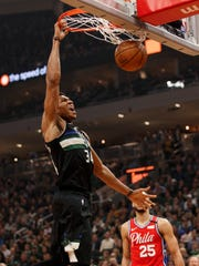 Bucks forward Giannis Antetokounmpo dunks against the Philadelphia 76ers during the first quarter Thursday night.