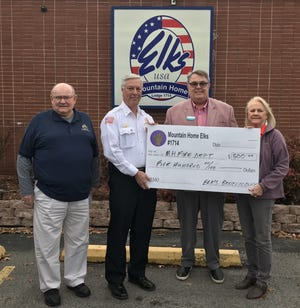The Mountain Home Elks Lodge No.1714 recently donated $500 to the Mountain Home Fire Department for their Stop, Drop, and Roll fire safety program and smoke detectors for families in need. Anyone wishing further information on the programs can call 425-2611. Pictured are (from left) Stuart Friend, Elks president; Gary Pyszka, MHFD Fire Marshal; Chris Robinson, Elks Benevolence chairman; and Patti Honeycutt, Elks Benevolence committee member.