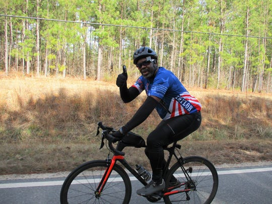 Rider from the Montgomery Bike Club wearing a Major Taylor Association t-shirt.
