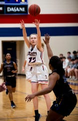 Trinity's Emma Kate Smith (12) puts up a three point shot against Catholic in the Class 4A, Area 4 girls championship game on the Trinity campus in Montgomery, Ala., on Thursday February 6, 2020.