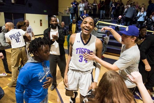 Tallassee's Tyrek Turner (34) celebrates after the game at Tallassee High School in Tallassee, Ala., on Thursday, Feb. 6, 2020. Tallassee defeated Brew Tech 44-41 to win the Class 5A, Area 4 boys championship.