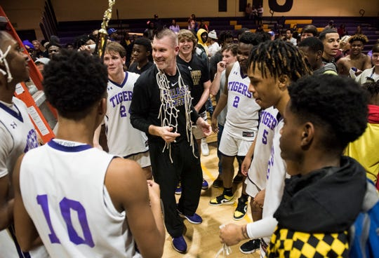 Tallassee Coach Keiven Mixson talks with his team after cutting down the net at Tallassee High School in Tallassee, Ala., on Thursday, Feb. 6, 2020. Tallassee defeated Brew Tech 44-41 to win the Class 5A, Area 4 boys championship.
