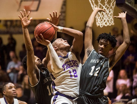 Tallassee's Tavarious Griffin (12) goes up for a layup at Tallassee High School in Tallassee, Ala., on Thursday, Feb. 6, 2020. Tallassee defeated Brew Tech 44-41 to win the Class 5A, Area 4 boys championship.