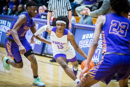 Central's Jayden Long dribbles past a Marion defender during their game at the Muncie Fieldhouse Thursday, Feb. 6, 2020.