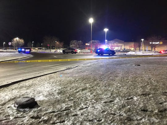 Muncie police early Friday used crime-scene tape to mark off a large area of the parking lot outside the Walmart store on East 29th Street after a man was fatally shot there.