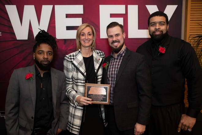 Ball State Athletics inducted Ball State's 2008 football team into the school's Hall of Fame. Here, BSU athletic director Beth Goetz stands with members of the team.
