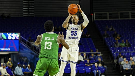 MTSU's Antonio Green (55) rises up for a 3-point attempt against North Texas on February 6, 2020.