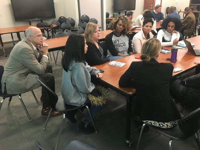 Williamson County Schools Superintendent Jason Golden, left, listens as parents and district staff discuss creating a more diverse pool of teachers at the district's quarterly Cultural Competency Council meeting in January.