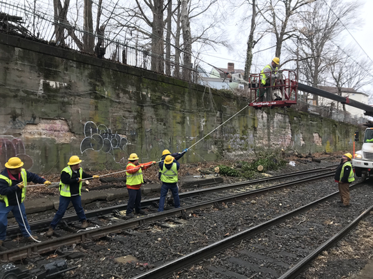 Crews work to clear a tree branch and a downed wire for NJ Transit trains on Feb. 7.