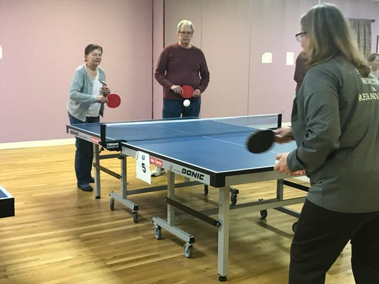 Linda Ferrari of Waldwick gets ready to receive a tennis ball during the first Ping Pong Parkinson meeting in Westwood on Feb. 6.