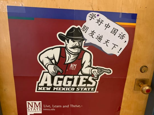 On a classroom door in Breland Hall on New Mexico State University's Las Cruces campus, university mascot Pistol Pete greets visitors to the Confucius Institute in Chinese on Thursday, Feb. 6, 2020.