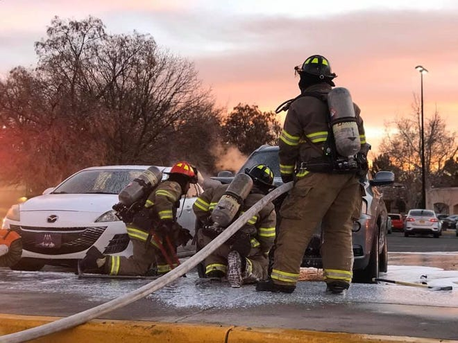 New Mexico State University firefighters extinguish a vehicle fire on campus at about 5:30 p.m. on Thursday, Feb. 6.