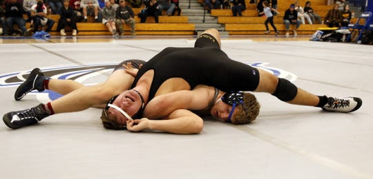 Carlsbad's Trystan Rogers (bottom) goes for a crucifix pin against Hobbs' Dexter Nelson in their 182-pound match on Feb. 6, 2020. Rogers recorded a pinfall victory and Carlsbad won, 62-15.