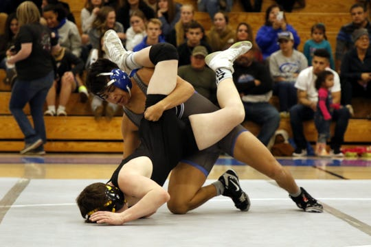 Carlsbad's Matthew Najera drives Hobbs' Kendall Herbst in their 132-pound match on Feb. 6, 2020. Najera won the match via technical fall and Carlsbad won the district duel, 62-15.